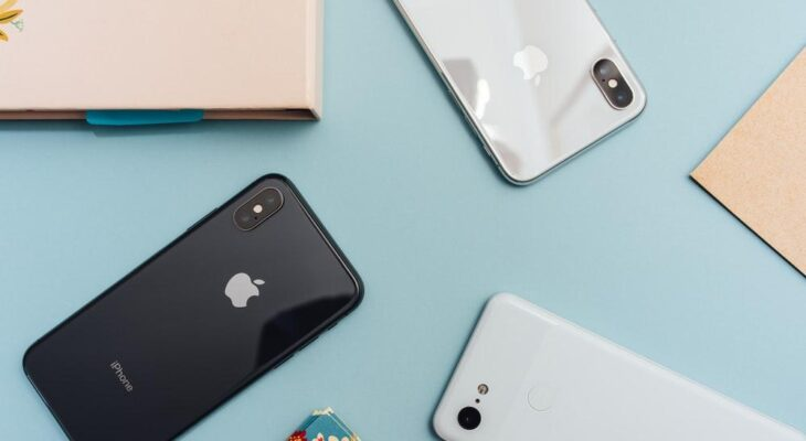 iPhone Prices in Malaysia space gray iPhone X on blue surface