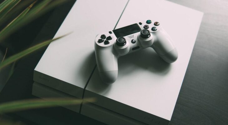 Sony PlayStation 4 Price in Malaysia selective focus photography of white Sony PS4 console with wireless controller